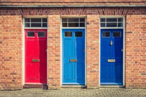 Three differently coloured front doors