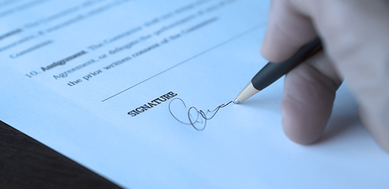 Hand signing document to commit business fraud