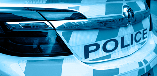 Close up of police car at a police station