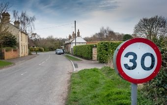 30mphj speed limit sign at entrance to English village