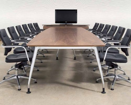 Conference meeting table with chairs and monitor